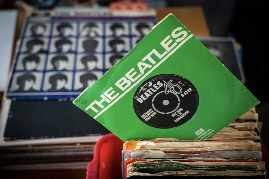 The Beatles collection vinyl, amongst other records laid out in a store.