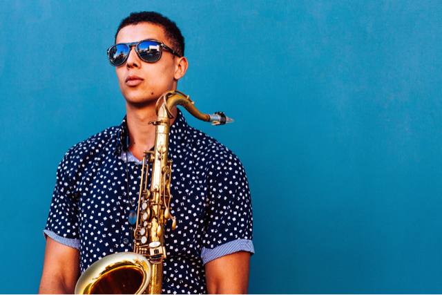 music job - session musician stands holding a saxophone