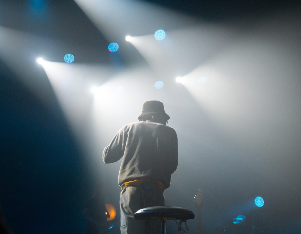 Man on stage by himself