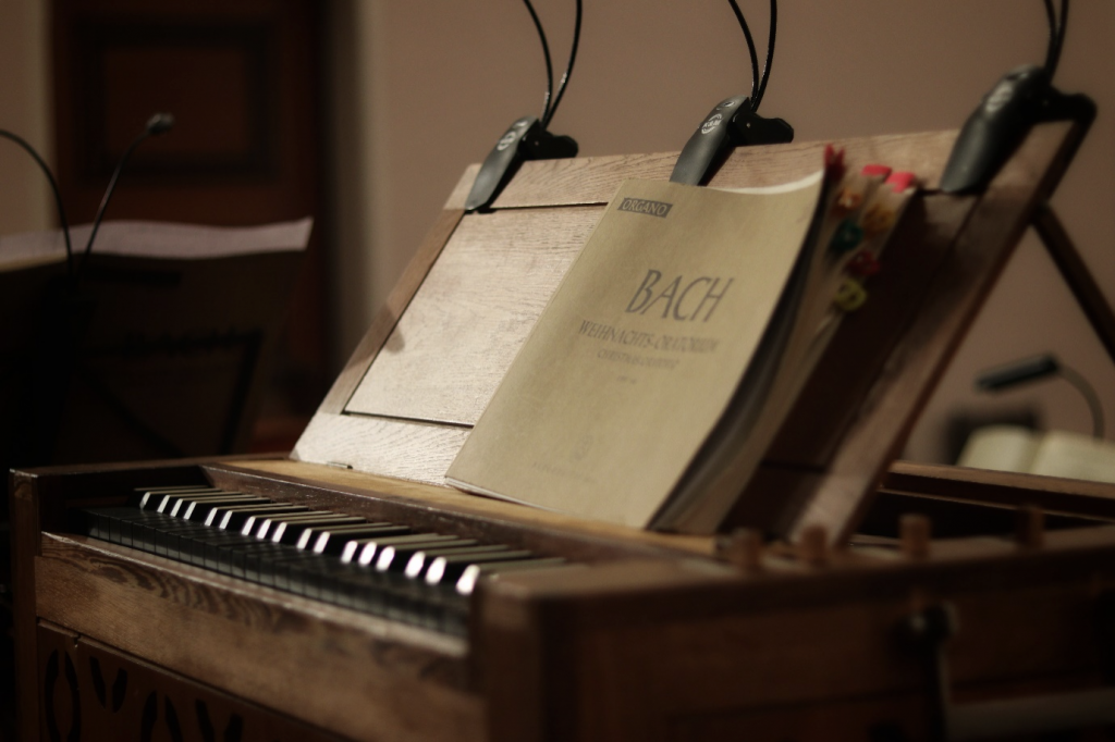 Photo of sheet music sat on a small piano